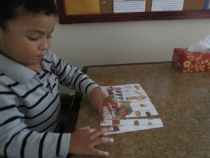 Alejandro working on a number puzzle.