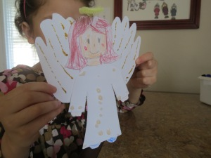 The wings were her traced hands : )